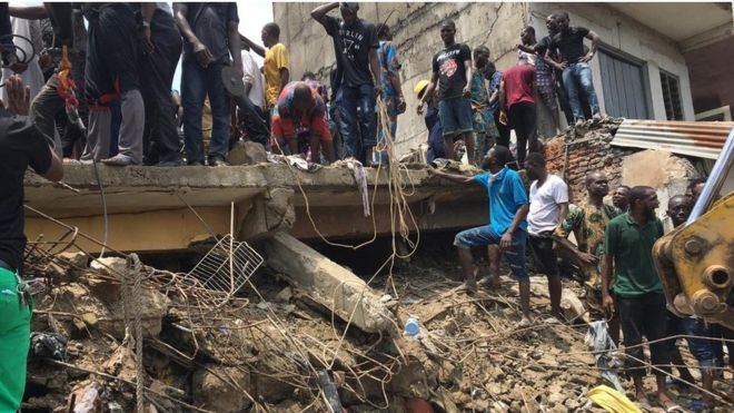 Rescuers search the rubble of a collapsed building in Lagos. 13 March 2019