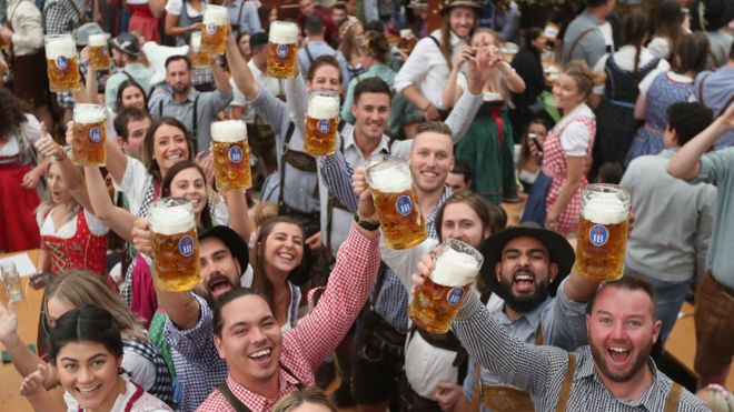 Visitors celebrate in a beer tent at the opening day of the 2018 Oktoberfest beer festival on September 22, 2018 in Munich, Germany.