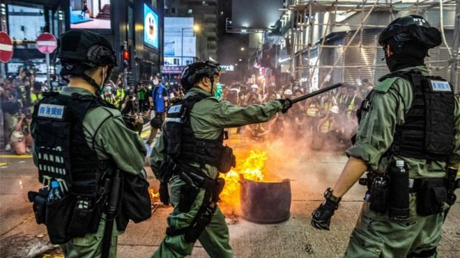 Police deter pro-democracy protesters from blocking roads in the Mong Kok district of Hong Kong on May 27, 2020