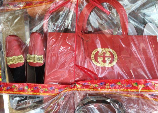 2923badd473 Gucci warns Hong Kong shops on paper fakes for funerals - BBC News