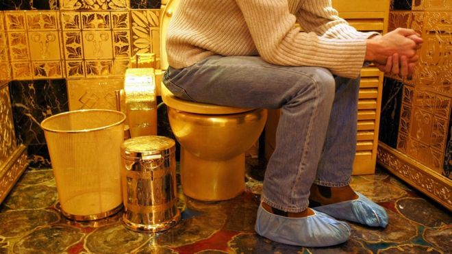 A solid gold and gem-encrusted toilet valued at 38,000,000 million Hong Kong dollars (4.8 million USD), pictured in 2005