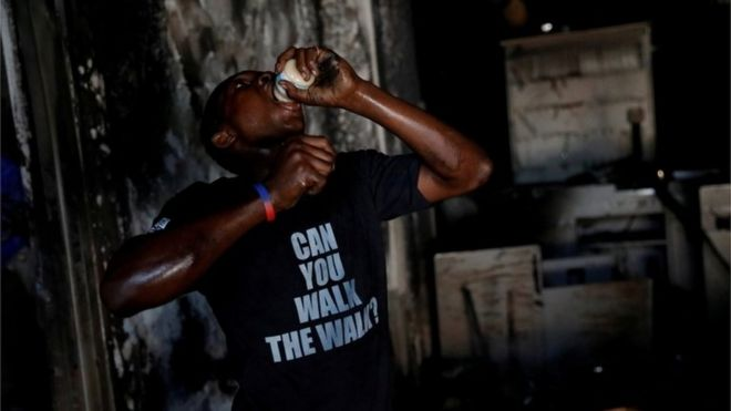 A boy eats a jar of baby food in a supermarket that was looted during protests against fuel price increases in Port-au-Prince, Haiti, July 8, 2018.