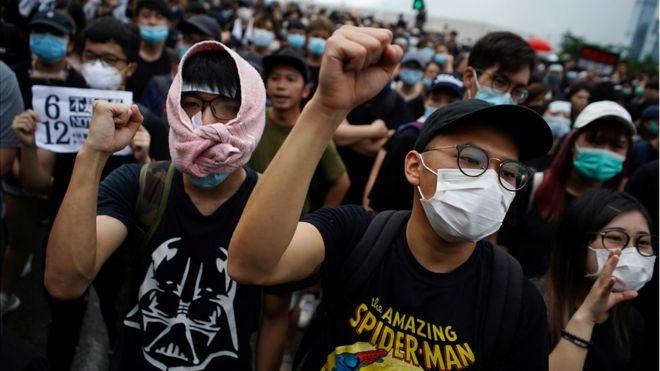 Protesters attend a demonstration demanding Hong Kong