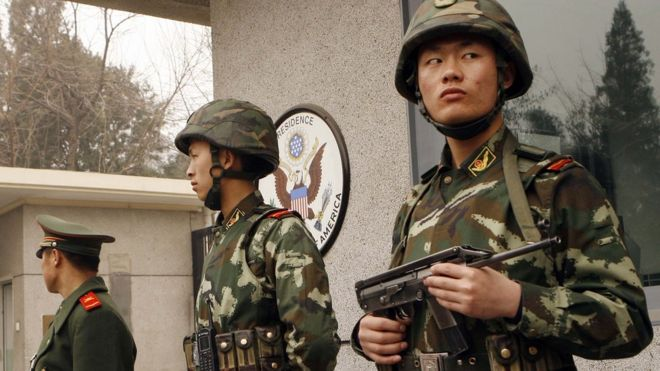 Three armed Chinese policemen guarding the US embassy in Beijing