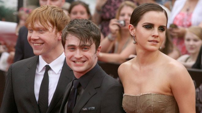 "Actors Rupert Grint, Daniel Radcliffe and Emma Watson attend the premiere of ""Harry Potter and the Deathly Hallows - Part 2"" at Avery Fisher Hall, Lincoln Center on 11 July, 2011 in New York City."
