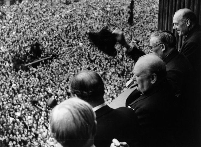 Prime Minister Winston Churchill addresses a huge crowd from a balcony in the Ministry of Health building on VE Day, 8 May 1945