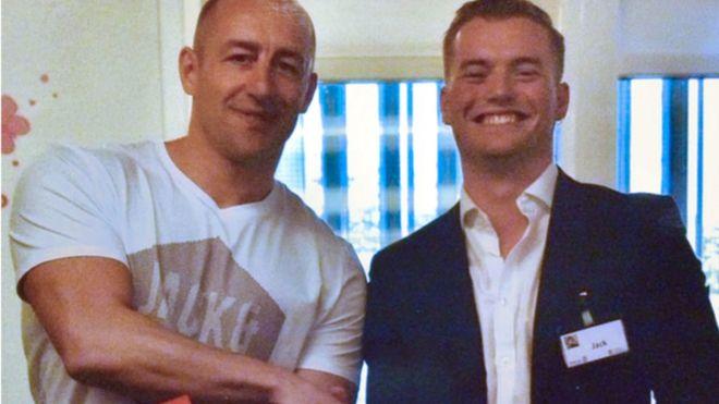 Steve Gallant, left, with Jack Merritt, right, shake hands