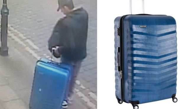 Abedi with suitcase