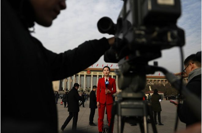 "A Chinese TV journalist makes her report in Tiananmen Square during the opening of the first session of the 13th National People""s Congress (NPC) at the Great Hall of the People in Beijing, China, 05 March 2018. The NPC has over 3,000 delegates and is the world""s largest parliament or legislative assembly though its function is largely as a formal seal of approval for the policies fixed by the leaders of the Chinese Communist Party. The NPC runs alongside the annual plenary meetings of the Chinese People""s Political Consultative Conference (CPPCC), together known as ""Lianghui"" or ""Two Meetings. EPA/HOW HWEE YOUNG EPA-EFE/HOW HWEE YOUNG"