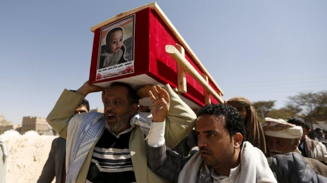 "People carry the coffin of a grandson of judge Yahya Rubaid, who was killed with his family by a Saudi-led air strike, in Yemen""s capital Sanaa"