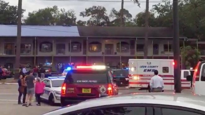 Emergency vehicles are parked outside the Hot Yoga studio where a guman opened fire in Tallahasee, Florida, U.S., November 2, 2018,