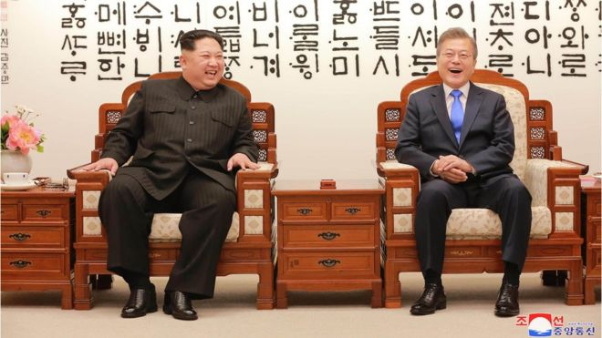 Kim Jong-un (L) talking with South Korea's President Moon Jae-in (R) before the inter-Korean summit at the Peace House building on the southern side of the truce village of Panmunjom on 27 April (picture released by North Korean state media)