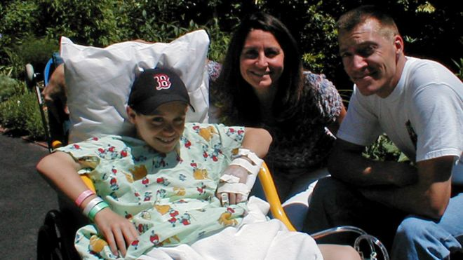 Luke Massella, aged 10 in 2001 with his mother and uncle, had to undergo surgery many times