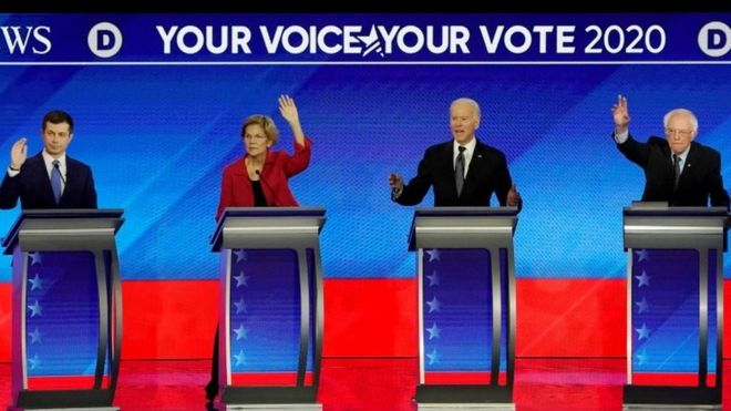 From left to right: Pete Buttigieg, Elizabeth Warren, Joe Biden and Bernie Sanders take part in the debate in Manchester, New Hampshire. Photo: 7 February 2020
