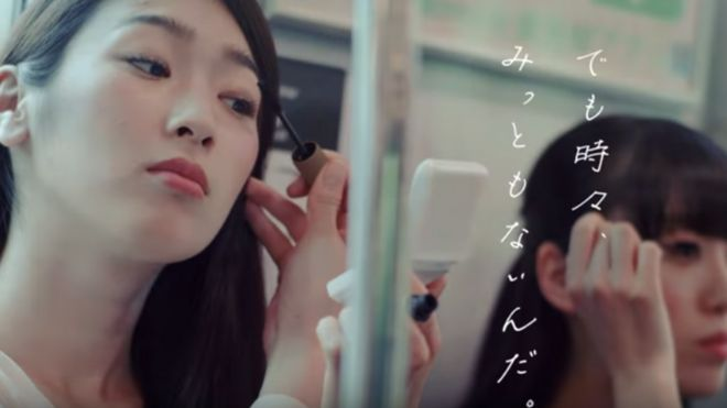 Japan etiquette video discourages applying make-up on trains - BBC News