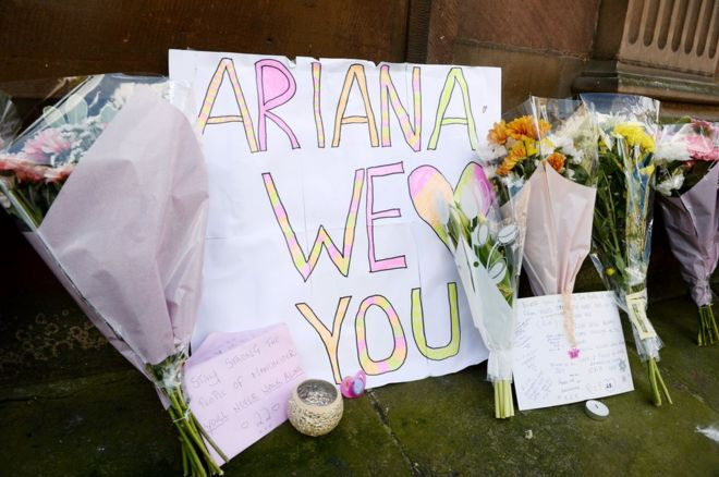 Tributes left outside St Ann's Church in Manchester