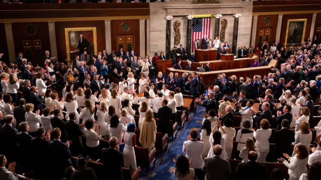 Democratic members celebrate in the House Chamber, as President Donald Trump recognizes their achievement of electing a record number of women to Congress