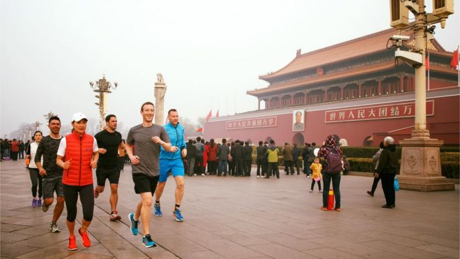 Facebook founder Mark Zuckerberg runs in Beijing's Tiananmen Square
