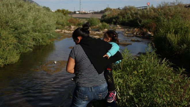 A woman on 19 May 2019 crosses the Rio Bravo, Mexico