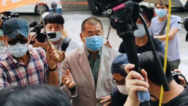 Jimmy Lai arrives at court for verdict