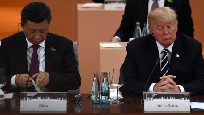 China's President Xi Jinping (L) and US President Donald Trump attend a working session on the first day of the G20 summit in Hamburg, northern Germany, on July 7, 2017