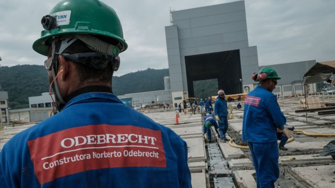 worker in hard hat with Odebrecht logo on back of uniform