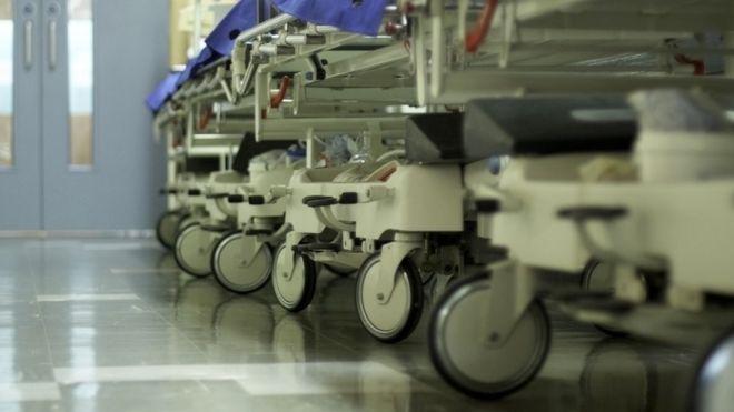 Hospital corridor with gurneys