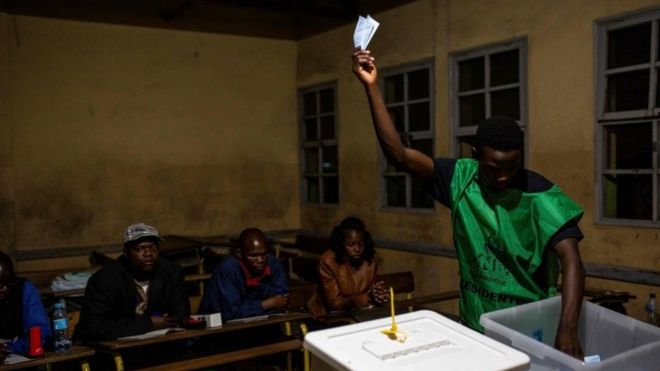 A National Electoral Commission (CNE) official counts votes at Chota Primary School in Beira on October 15, 2019, as part of the general election.