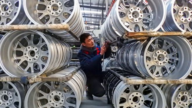 A factory worker with wheels in a Chinese factory