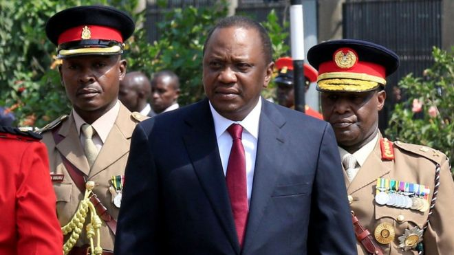 Kenya's President Uhuru Kenyatta inspects the honour guard before the opening of the 12th Parliament outside the National Assembly Chamber in Nairobi, 12 September 2017