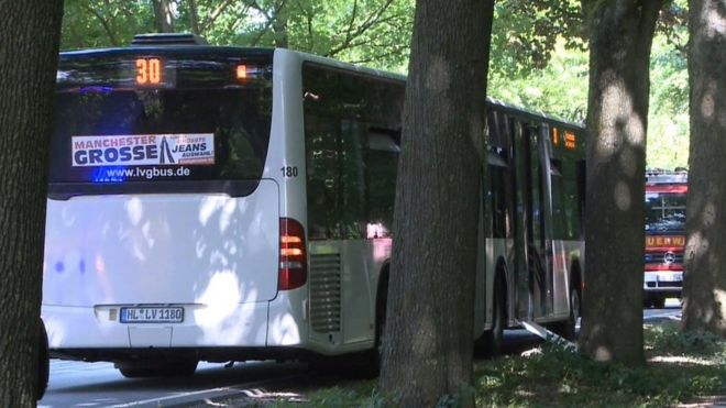 A public service bus stands in Kücknitz near Lübeck, northern Germany, after several people were injured in the bus in an assault by a man wielding a knife on July 20, 2018.
