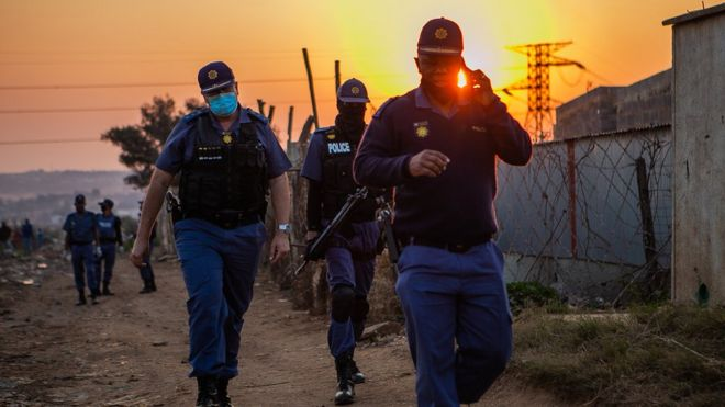 South African police enforce lockdown restrictions, which have been some of the harshest in the world
