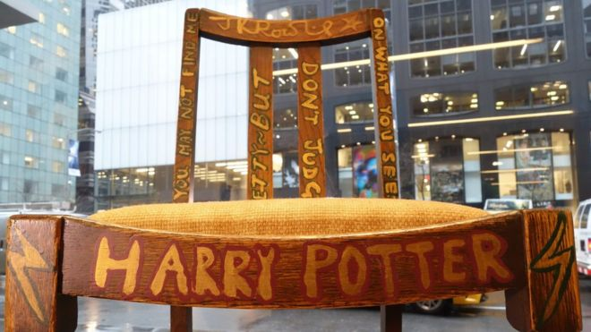 A chair used and later decorated by author JK Rowling while she wrote the & Harry Potteru0027 chair sold for almost $400000 at auction - BBC News
