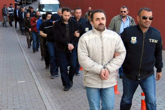 Members of the Turkish police escort suspects of the Gulen movement during nationwide operations, in Kayseri city, Turkey, 26 April 2017.