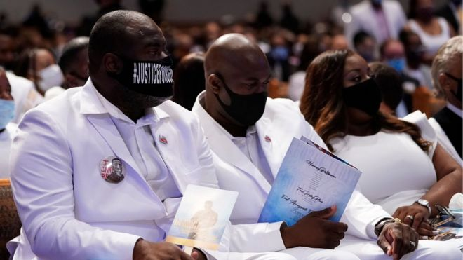 Image shows Rodney Floyd (L) and Philonise Floyd (C) brothers of George Floyd, attending their brother's funeral service