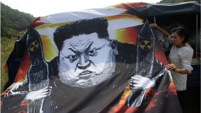 A North Korean defector, now living in South Korea, prepares to release balloons carrying propaganda leaflets denouncing recent North Korea's nuclear test, near the Demilitarized Zone (DMZ) on September 15, 2016 in Paju, South Korea.