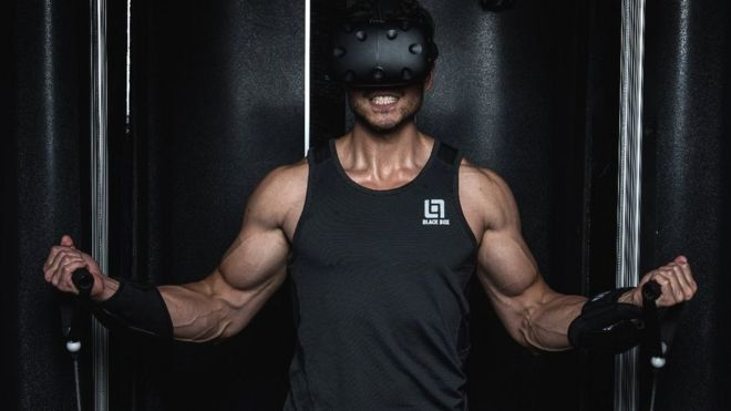 Man using VR gym kit