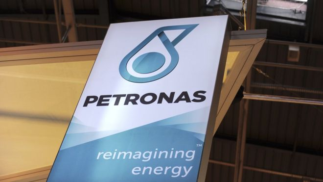 A picture shows the logo of Malaysian state energy firm Petronas during the World Gas Conference exhibition in Paris on June 2, 2015.