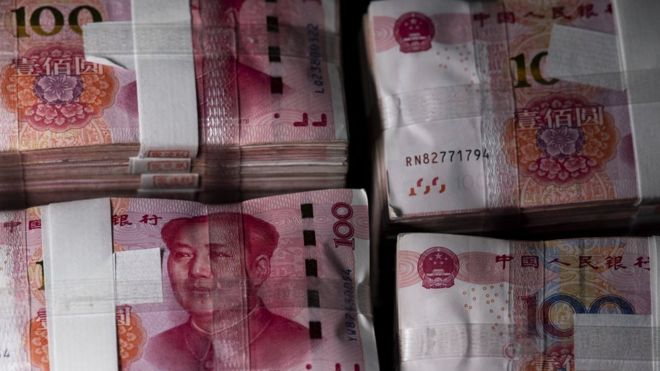 Trump accuses China of 'manipulating' its currency - BBC News