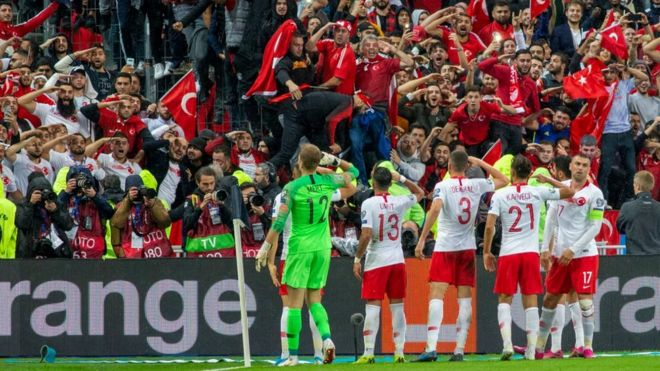 The Turkish players' military salute was greeted by fans copying their actions at the Stade de France on Monday night