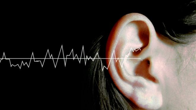 Sound waves and a woman's ear generic