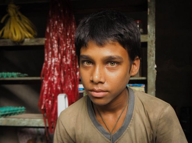 Bangladesh, 2014. A boy poses for a portrait.
