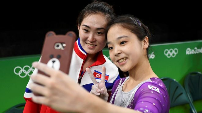 Lee Eun-Ju (KOR) of South Korea (R) takes a selfie picture with Hong Un Jong (PRK) of North Korea