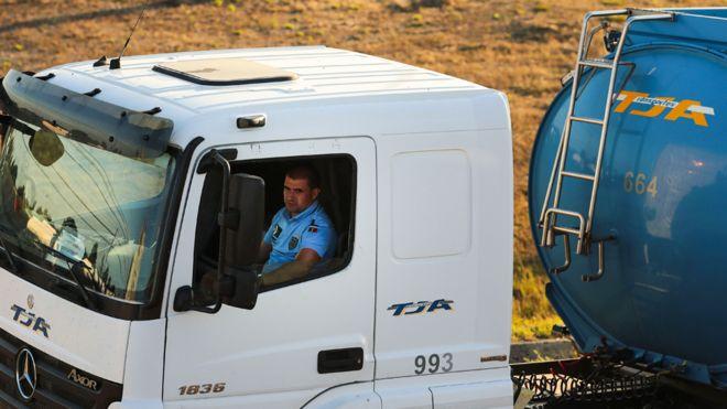 Portugal police drive fuel trucks as strike bites - BBC News