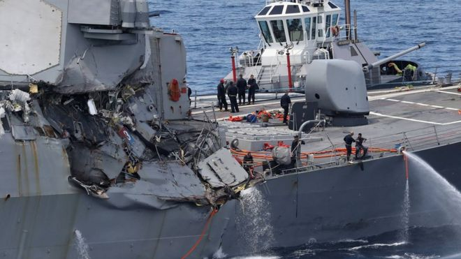 damages on the guided missile destroyer USS Fitzgerald off the Shimoda coast after it collided with a Philippine-flagged container ship on June 17, 2017.