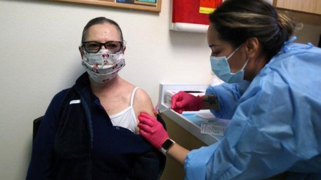 Francisca Bojorquez receives a Covid-19 vaccine at East Valley Community Health Center in La Puente, California, 5 March 2021.