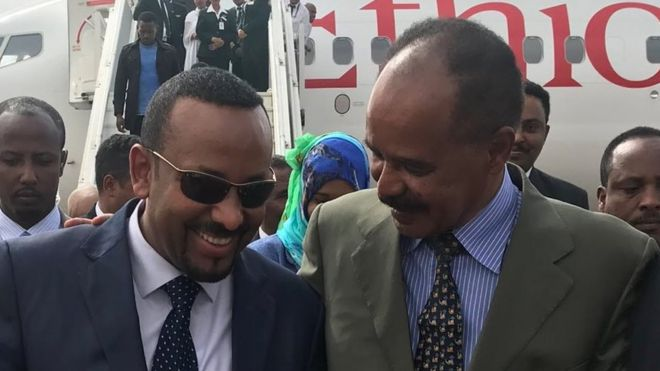 President Isaias Afwerki puts his arm around Prime Minister Abiy Ahmed