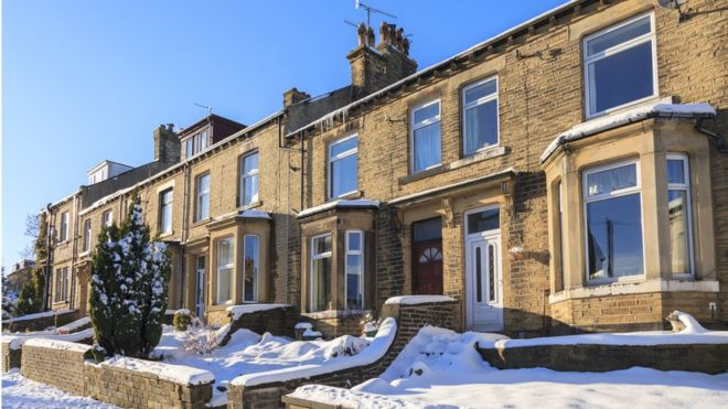 row of houses in the snow
