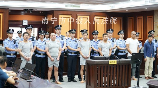 The six defendants in court in Nanning