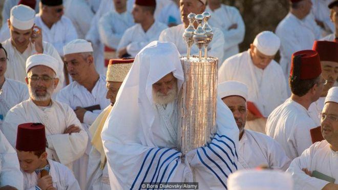 The Samaritan Torah has three crowns on it to represent their three tribes of origin